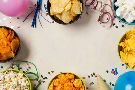 Background with snacks, balloons, party hat, confetti. Perfect for a party. Top view.