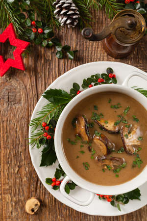 Traditional mushroom soup, made from porcini mushrooms. Christmas decoration. Top view.