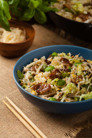 Fried veal, with rice, Chinese cabbage and mushrooms. 写真素材
