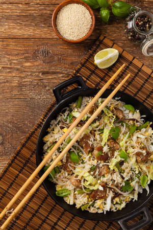 Fried veal, with rice, Chinese cabbage and mushrooms
