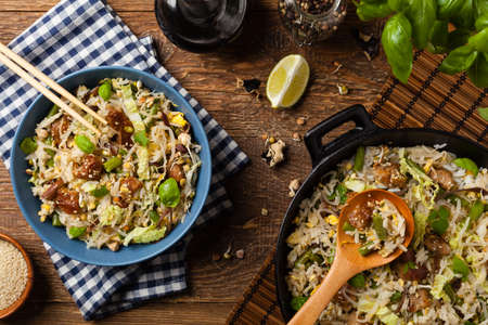 Fried veal, with rice, Chinese cabbage and mushrooms. Sprinkled with sesame and soy sauce. Top view.  Stockfoto