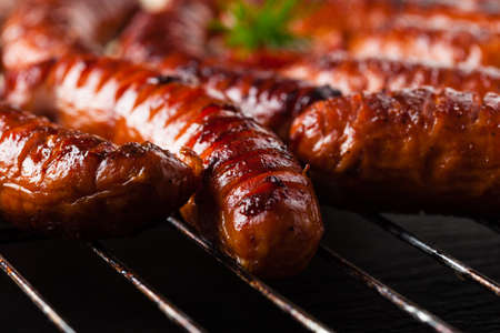 Grilled sausages. Front view.  Фото со стока