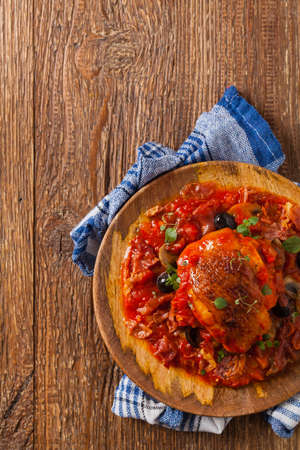 Traditionally made chicken in tomato sauce cacciatore. Top view. Flat lay.
