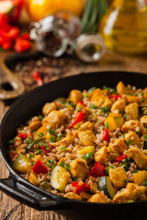 Buckwheat with chicken and vegetables. Front view.