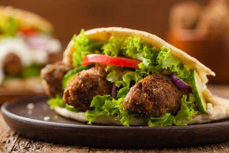 Kebab, kofta in pita, bun. Traditional southern European dish. Front view.  Фото со стока