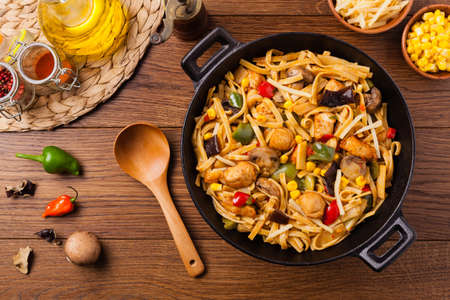Indonesian pasta with chicken, pieces of bamboo and mushrooms. Top view.