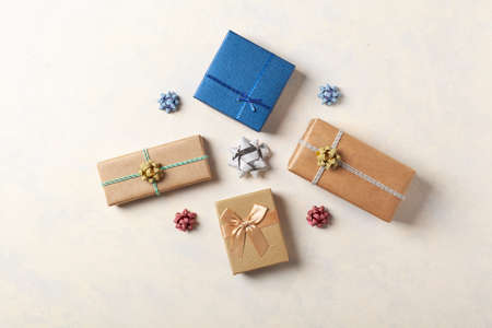 Gift Wrapping. A bright background with packaging accessories and gifts. Creative composition. Place for description. Top view.