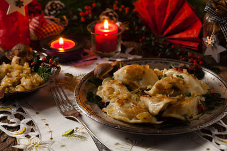Traditional dumplings with cabbage and mushrooms. Christmas decoration. Top view. Front view.