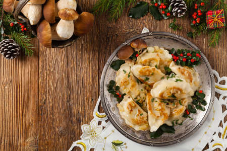 Traditional dumplings with cabbage and mushrooms. Christmas decoration. Top view.