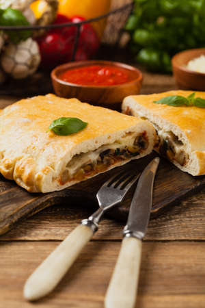 Italian calzone with mushrooms and ham. Front view.