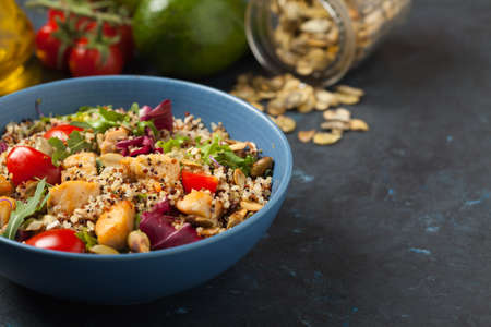 Salad with quinoa, avocado and chicken. Front view. Served in a blue bowl. 写真素材