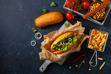 Vegetarian hot dogs with soy sausages and fresh vegetables. Top view.