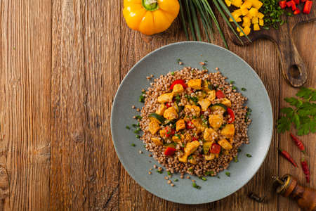Buckwheat with chicken and vegetables. Top view.