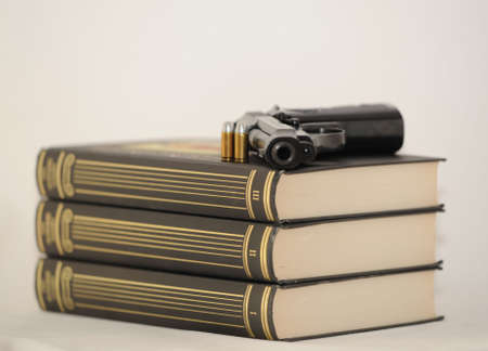 Pistol And Cartridges On Three Books. Detective Story.