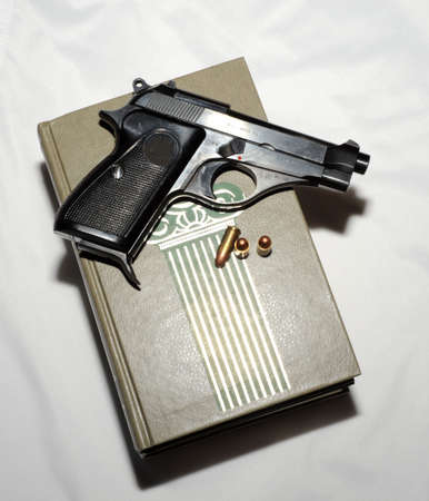 Pistol And Cartridges On  Book. Detective Story.
