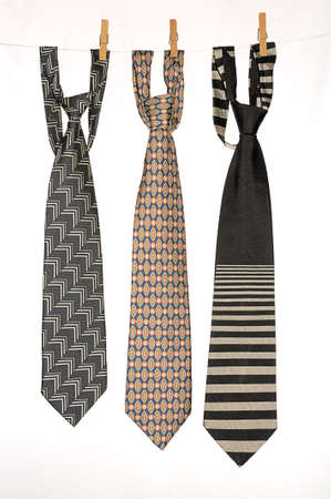 Three Ties Hanging On a Rope With Wooden Pegs. 版權商用圖片