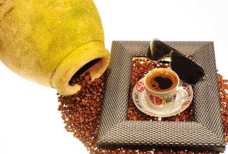 tripped: Coffee Beans Tripped Out From a Clay Pottery Called Amphora.