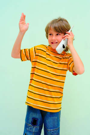 Teen Boy Relax By Talking On Wireless Telephone. photo