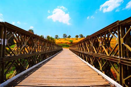 The Old Bridge Passing Through Jordan River in North Galilee, Israel. photo