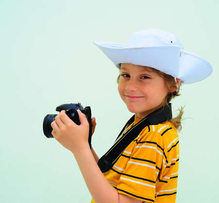 Lovely Young Photographer With Camera Against The Light Green Wall. photo