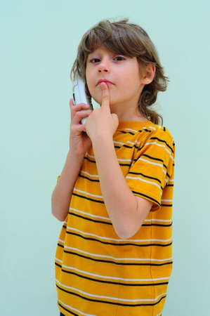Teen Boy Relax By Talking On Wireless Telephone photo