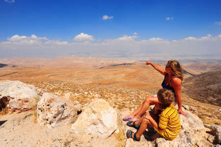 Boy And Woman Looking At The Judea Mountains Near Dead Sea Stock Photo - 5284001