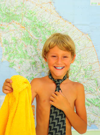 Little Boy With Tie And Bath Towel Near The Map Stock Photo - 5283998