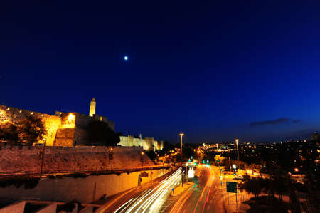 Night View of Ancient Walls Surrounding Old City in Jerusalem photo