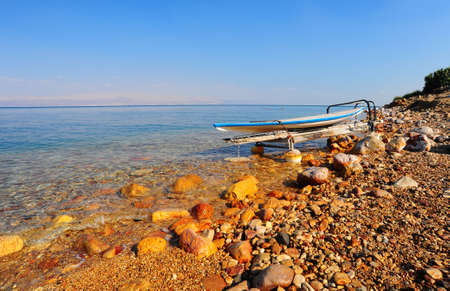 Salt Glazed Board For Windsurfing On The Beach Of Dead Sea. photo