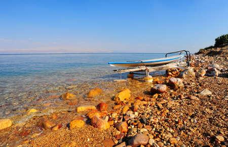 Salt Glazed Board For Windsurfing On The Beach Of Dead Sea. photo