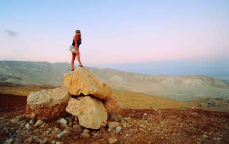area sexy: Woman Posing On The Judea Mountain Top At Sunset Stock Photo