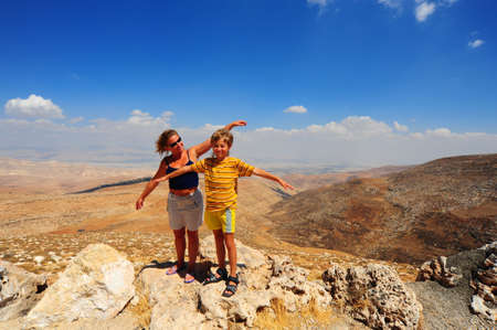 judea: Woman And Boy  Posing On The Judea Mountain Top  Stock Photo