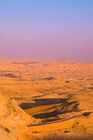 Meandering Road In Sand Hills Of Negev Desert, Sunset photo
