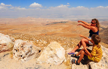 Woman And Boy  Posing On The Judea Mountain Top Stock Photo - 5674125
