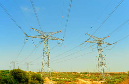 sandbar: Row Of High Voltage Electricity Pole In Sandbar Stock Photo