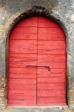 Close-up Image Of Red Wooden Ancient Italian Door photo