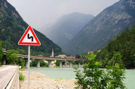 Dangerous Curves Sign At The Road Along Adige River in The Alps photo