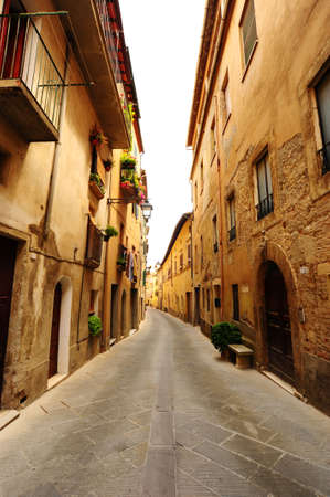 Narrow Alley With Old Buildings In Typical Italian Medieval Town photo