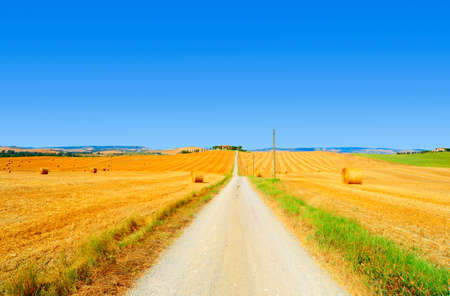 Tuscany Landscape With Many Hay Bales At The Rural Road  photo