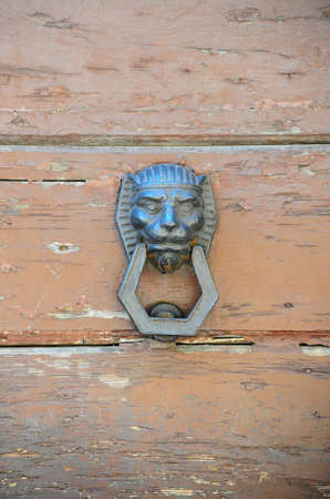 Door Knocker In The Form Of a Lions Head photo