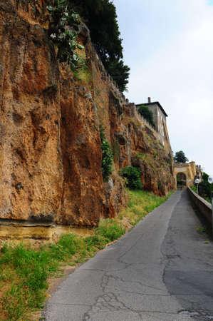 Narrow Asphalt Road With Old Buildings In Italian City  photo