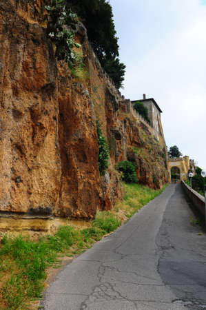 Narrow Asphalt Road With Old Buildings In Italian City  photo