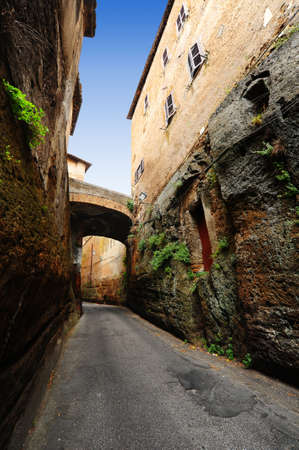 Narrow Alley With Old Buildings In Italian  Medieval City  photo