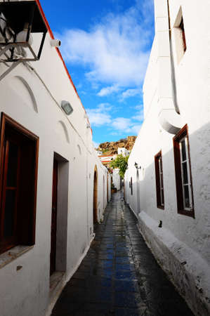 Narrow Alley With Old Buildings In Typical Greek City Stock Photo - 8604885