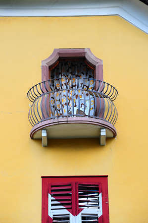 Decorated Closed Windows Of Old Building In Pisa, Italy photo