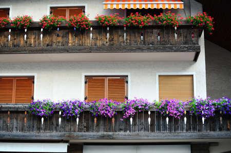 Typical Wooden Loft Decorated With Fresh Flowers in the Italian Alps photo