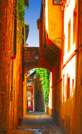 Narrow Alley With Old Buildings In Italian City of Pisa
