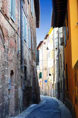 Narrow Alley With Old Buildings In Italian City of Pisa photo