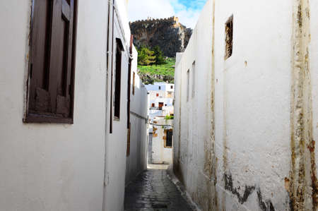 Narrow Alley With Old Buildings In Typical Greek City photo