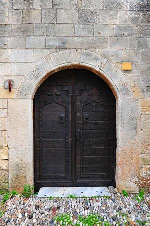 antica grecia: Immagine di Close-up della porta in legno della Grecia antica